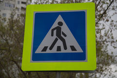 Road sign pedestrian crossing Russia blue yellow background Royalty Free Stock Photos