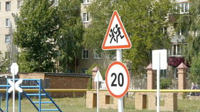 Road sign pedestrian paths and speed limits.  stock footage