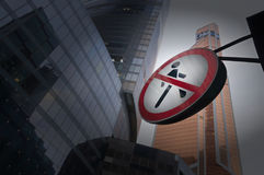 Road Sign Pedestrians are forbidden to pass among the skyscrapers Royalty Free Stock Photography