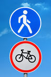 Road sign permission for pedestrians and bicycle ban. On blue sky background Royalty Free Stock Images