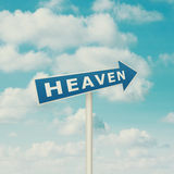 Road sign pointing to heaven Stock Images