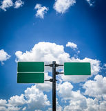 Road  sign pole and blue sky Stock Images