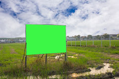 Road with sign pole and blue sky with clouds,chroma key green.  Stock Images