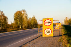 Road with sign pole and blue sky with clouds Royalty Free Stock Photos