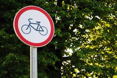 No cycling sign in the park on green tree background royalty free stock photography