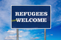 The road sign with Refugees Unwelcome sign Stock Image