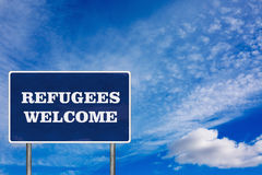 The road sign with Refugees welcome sign. The road sign symbol with Refugees welcome sign royalty free stock image