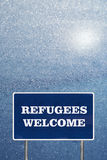 The road sign with Refugees welcome sign Stock Photos