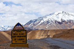 Road sign on the road between Manali and Leh, India. Road sign on the road between Manali and Leh high in the mountains of Ladakh, India Royalty Free Stock Photos