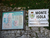 Road sign and road map of Peschiera Maraglio hamlet in Monte Isola island, Lombardy, Italy. MONTE ISOLA, ITALY - MAY 13, 2017: Road sign and road map of Royalty Free Stock Images