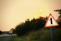 Road sign at the roadside. At sunset Stock Images