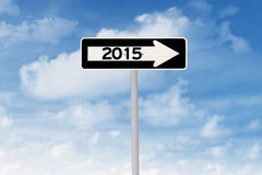 Road sign with route to 2015 Stock Image