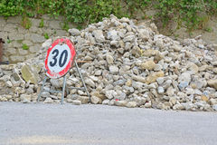 Road sign and rubble Stock Images