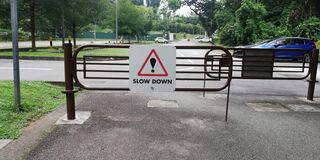 Free Road Sign Saying Slow Down Royalty Free Stock Image - 195877416