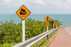 Road sign on the sea road Royalty Free Stock Image