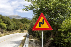 Road sign `A sharp turn`. On a mountain road royalty free stock photo
