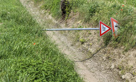 Road sign shot down in the countryside Stock Photos