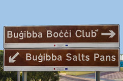 Traffic signs - Malta. Road sign showing the way to some popular tourist attractions - Bugibba, Malta Stock Photo