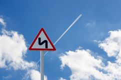 Road sign on sky background. The trace of the plane royalty free stock photo