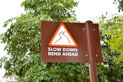 Road Sign, Slow Down Bend Ahead Royalty Free Stock Photos