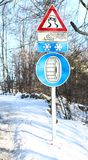 Road sign with snow chains aboard the car Stock Photo