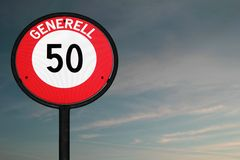 Road sign speed limit 50 at dusk Royalty Free Stock Photography