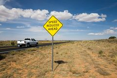 Road sign speed reduced ahead Royalty Free Stock Images