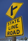 Road sign `State Line Road`. North American road sign saying `State Line Road Royalty Free Stock Images