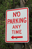 Road sign stating NO PARKING AT ANY TIME Royalty Free Stock Images