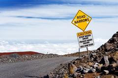 A road sign on a steep road to the summit of Mauna Kea, a dormant volcano on the island of Hawaii Royalty Free Stock Image