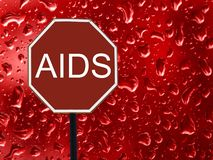 Road sign stop AIDS and red blood drop on the glass royalty free stock photography