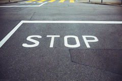 Road sign STOP. Stop sign on asphalt, related to urban traffic Stock Photo