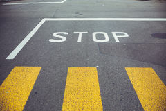 Road sign STOP. Stop sign on asphalt, related to urban traffic Stock Photos