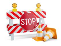 Road sign STOP on fence and traffic cones Royalty Free Stock Image