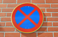 Road sign The stop is forbidden is fixed on a red brick wall Royalty Free Stock Image