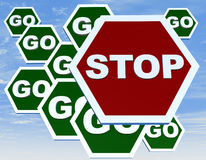 Road sign with stop and go Royalty Free Stock Images