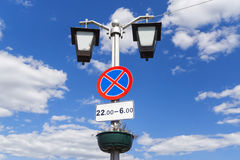 Road sign stop is on lamp post Stock Images