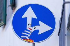 Road sign, street art. Road sign with funny box on the signal, street art, metropolitan art royalty free stock photography