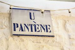 Road sign with street dialect name in a Puglia road Royalty Free Stock Photos