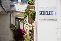 Road sign with street dialect name in a Puglia road Stock Photos