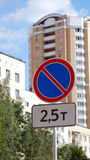 Road sign on the street. The parking of cars is forbidden. Road sign on the street. The parking of cars weighing 2,5 tons is forbidden also above Royalty Free Stock Photo