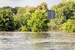 Road sign submerged in flood water in Gdansk, Poland. Stock Photo