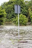 Road sign submerged in flood water in Gdansk, Poland. Royalty Free Stock Images