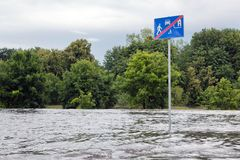 Road sign submerged in flood water in Gdansk, Poland. Royalty Free Stock Photo