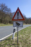 Road Sign- Take care of toads. Springtime is toads time! This road sign tells the traffic members to take care of toads, cause they are crossing the road looking Royalty Free Stock Image