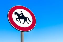 Road sign to prohibit passage with horse. Road sign to prohibit passage with horse - Red White Black Stock Photo
