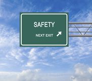 Road sign to safety Royalty Free Stock Photos