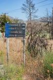 Road sign to villages: Apolakkia, Arnitha, Genandi, Vati, burnt after bushfire Rhodes, Greece stock photos