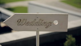 Road sign to wedding ceremony. Sequence stock footage