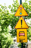 Road sign traffic light and attention. Krakow. Poland stock image